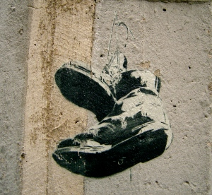 Hanging boots stencil in Sparks Lane, Melbourne
