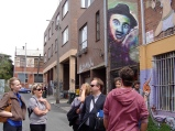 Makatron (in the red hoodie) conducts a tour of Fitzroy graffiti