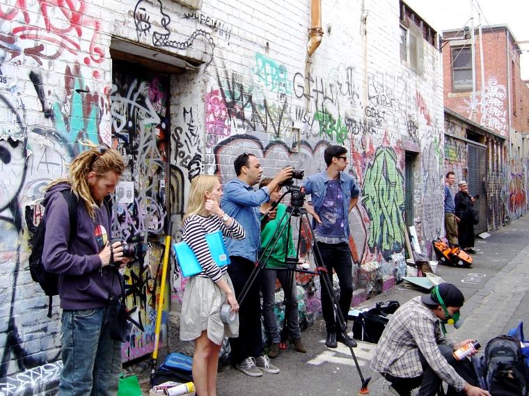 Media watching street art Fitzroy