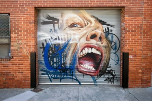 Adnate work in Richmond at a building scheduled to be redeveloped into apartments