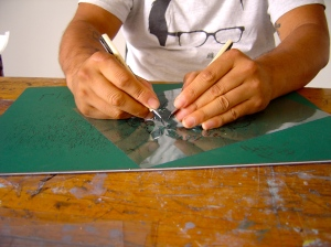 HaHa cutting stencils with both hands.