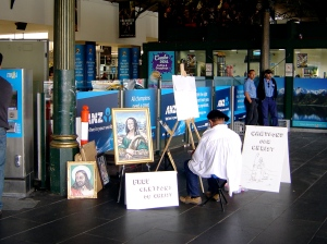 Artist painting at Flinders Street