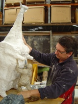 John Kelly with maquette for Man Lifting Cow